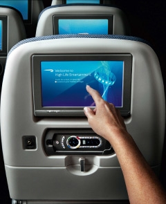 Touchscreen in the back of the seat.